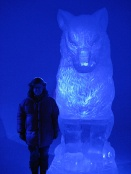 My wife next to a wolf carved from ice